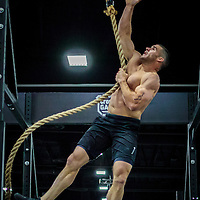 Tommy Hackenbruck finishing a rope climb on the way to winning the CrossFit Southwest Regionals.