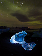 """Jökulsárlón (literally """"glacial river lagoon"""") is a large glacial lagoon in southeast Iceland, on the borders of Vatnajökull National Park. Situated at the head of Breiðamerkurjökull, it evolved into a lagoon after the glacier started receding from the edge of the Atlantic Ocean."""