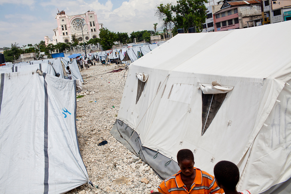 The destroyed cathedral serves as a backdrop to a small camp for people whose homes were destroyed in the earthquake on July 6, 2010 in Port-au-Prince, Haiti.