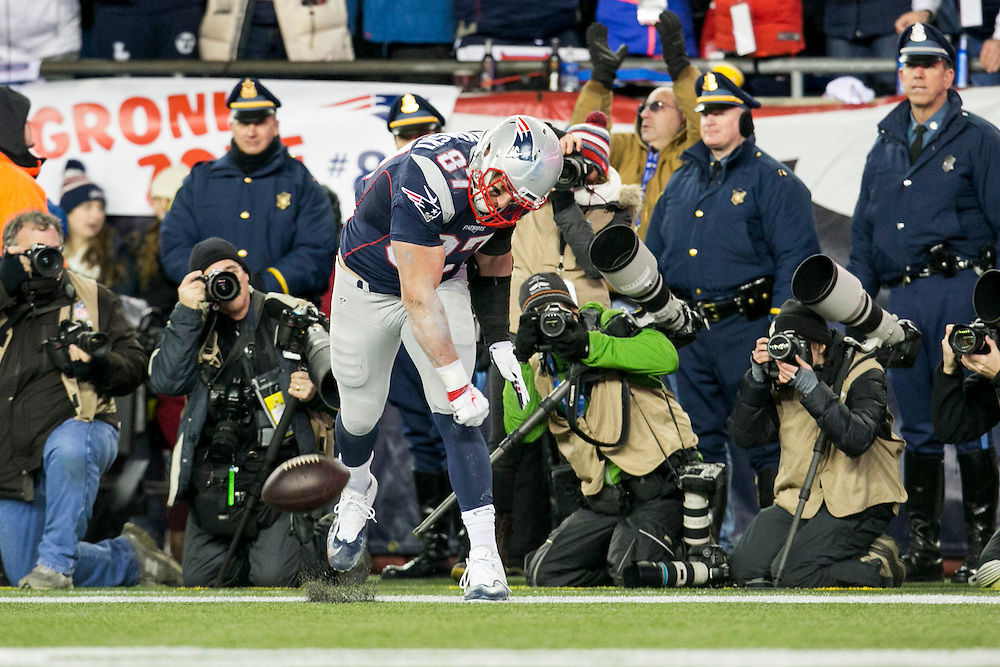 New England Patriots tight end Rob Gronkowski (87) spikes the football in celebration after scoring against the Kansas City Chiefs in the third quarter of the AFC Divisional Playoff game at Gillette Stadium in Foxborough, Massachusetts on January 16, 2016. The Patriots defeated the Chiefs, 27-20.    Photo by Kelvin Ma/ UPI