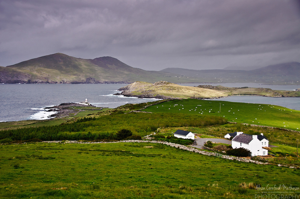 Cromwell Point Lighthouse, Valentia Island with a background view of Killelan Mountain and Beginish Island View of the Atlantic Coast from Gortgower, Valentia Island, County Kerry, Ireland.