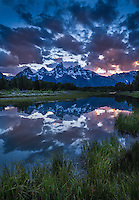 Sunset refelction of the Tetons and pretty clouds at Schwabacher Landing, Grand Teton National Park, Wyoming