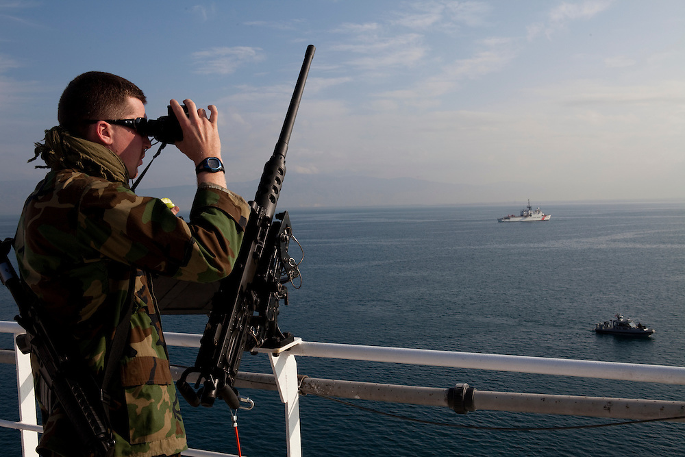 U.S. Navy MA3 Jason Kaye keeps watch on board the USNS Comfort, a naval hospital ship, on Wednesday, January 20, 2010 anchored off Port-Au-Prince, Haiti. The Comfort deployed from Baltimore, bringing nearly a thousand medical personnel to care for victims of Haiti's recent earthquake.