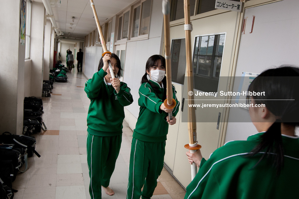 in Fukushima, Japan, on Tuesday 31st May 2011. Members of the Watari Junior High School girls Kendo team do their training indoors in a school corridor, due to restrictions on their use of outdoor school grounds due to high levels of nuclear radiation fallout from the Fukushima Daiichi plant crisis, in Fukushima, Japan, on Tuesday 31st May 2011.