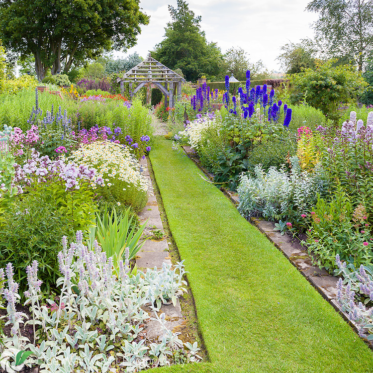 Rich herbaceous planting at Wollerton Old Hall Gardens, Shropshire.