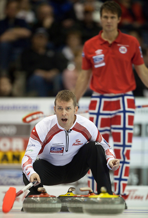 Canada's Skip Jeff Stoughton calls to his teammates during Canada's match against Norway in the evening draw at the Ford World Men's Curling Championships at the Brandt Centre in Regina, Saskatchewan, April 7, 2011.<br /> AFP PHOTO/Geoff Robins