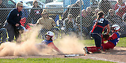 Bailey Brownfield of Lakewood, slides safely into home plate while teammate Mallory Huber taken out by Licking Valley catcher Kori Caughenbaugh. Licking Valley girls softball hosted Lakewood in a Licking County League game. Licking Valley won 8-5.