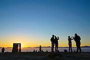 Sunrise at Mount Pisgah summit on January 1st, with people taking selfies at the Jed Kesey memorial sculpture, Lane County, Oregon.
