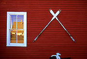 Image of a wall with oars, town of Bernard on Mount Desert Island, Maine, American Northeast
