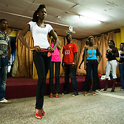 Nana Yaa Adadewa Addo (second left), 24, prepares to practice her catwalk during a rehearsal in Ghana's capital Accra on Thursday May 21, 2009. Nana Yaa is one of several Ghanaian girls who auditioned for the upcoming television show West Africa's Next Top Model, the latest incarnation of Tyra Banks' America's Next Top Model.