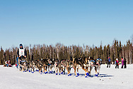 Musher Cody Strathe competing in the 44th Iditarod Trail Sled Dog Race on Long Lake after leaving the restart on Willow Lake in Southcentral Alaska.  Afternoon. Winter.