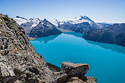 From stunning Panorama Ridge, admire the vibrant turquoise color of Garibaldi Lake, which comes from glacial flour suspended in meltwater from Sphinx and Sentinel Glaciers. Above the lake rise Mount Garibaldi (2678 m or 8786 ft), a potentially active stratovolcano. Garibaldi Provincial Park is east of the Sea to Sky Highway (Route 99) between Squamish and Whistler in the Coast Range, British Columbia, Canada. A hiking loop to Garibaldi Lake via Taylor Meadows Campground is 11 miles (18k) round trip, with 3010 ft (850m) gain. Panorama Ridge is 6 miles (10k) RT with 2066 ft (630m) gain from either Taylor Meadows or Garibaldi Lake Campground (or 17 miles RT with 5100 ft gain from Rubble Creek parking lot).