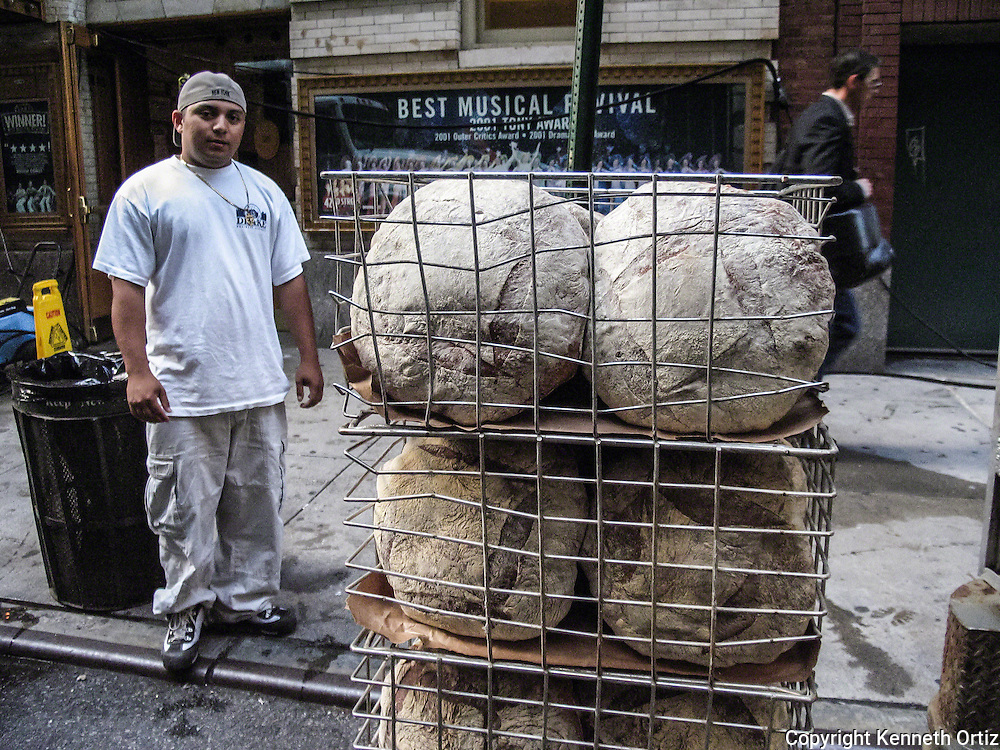 A delivery guy prepares to make his bread deliveries.