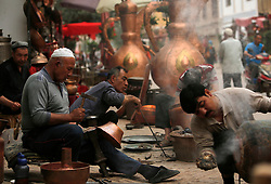 A picture made available on 31 May 2013 of craftsmen of the Uighur  ethnic group working on bronze wares in Kashgar, western edge of China's Xinjiang Uighur Autonomous Region, China 24 May 2013. Uighurs, a Muslim ethnic minority group in China, make up about 40 per cent of the 21.8 million people in Xinjiang, a vast, ethnically divided region that borders Pakistan, Afghanistan, Kazakhstan, Kyrgyzstan and Mongolia. Other ethnic minorities living in here include the Han Chinese, Kyrgyz, Mongolian and Tajiks people. In the restive region of Kashgar, western end of Xinjiang where the North and South Silk road meets, Uighurs comprise of more than 90 per cent of the 3.9 million population. Most practice a moderate form of Islam and religion is a major part of most ordinary Uighurs' lives. Tensions have been high between the Uighurs and the dominant Han Chinese as Uighurs complain of cultural and religious repression and claim that Han Chinese migrants enjoy the main benefits of development in the oil-rich but economically backward region.