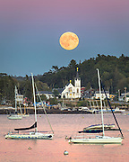 An incredibly beautiful full moon rises behind Our Lady of Peace Church in Boothbay Harbor. I took this photo from almost 5,000 feet away at the Boothbay Harbor Yatch Club. A 400mm lens compressed the scene to make it appear very large in the field of view.