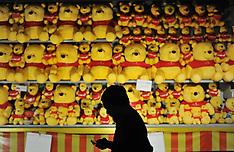 NOV 29 2013 A man in silhouette walk past a teddy bear on display
