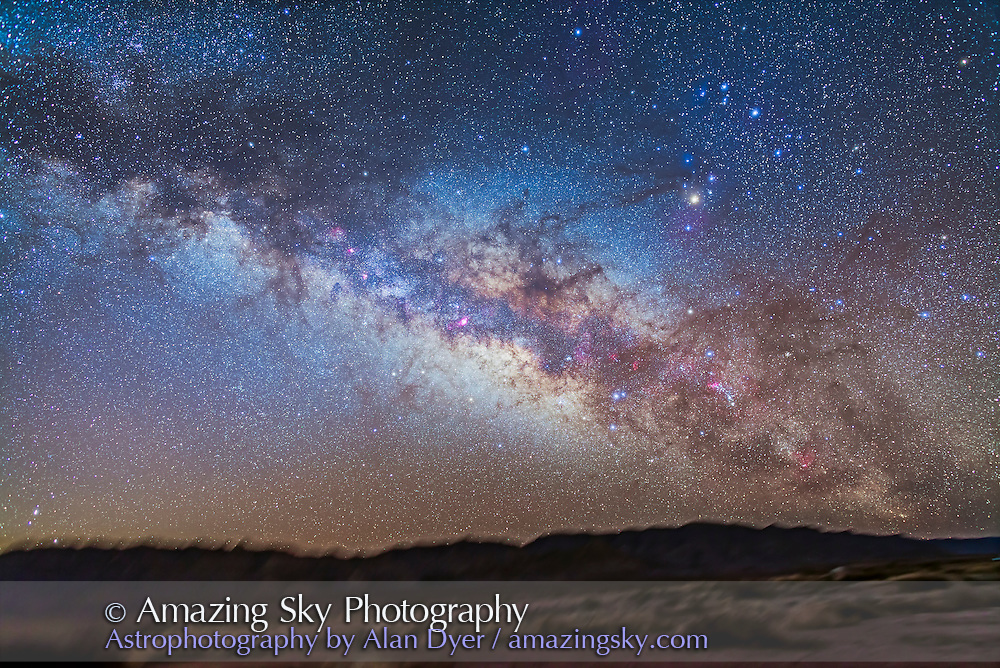 The centre of the Galaxy in Sagittarius and Scorpius rising above the southeast horizon, from New Mexico, at the Painted Pony Resort. This is a stack of 5 x 5 minute exposures with the 24mm lens at f/2.8 and Canon 5D MkII at ISO 800. The landscape is from one exposure and shadow detail brought out. An additional image shot thru the Kenko Softon filter was layered in to add the star glows.