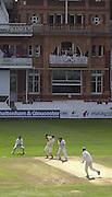 Photo Peter Spurrier.01/09/2002.Village Cricket Final - Lords.Elvaston C.C. vs Shipton-Under-Wychwood C.C..Shipton batting, Phil Garner on strike, as the the Shipton balcony watches on.