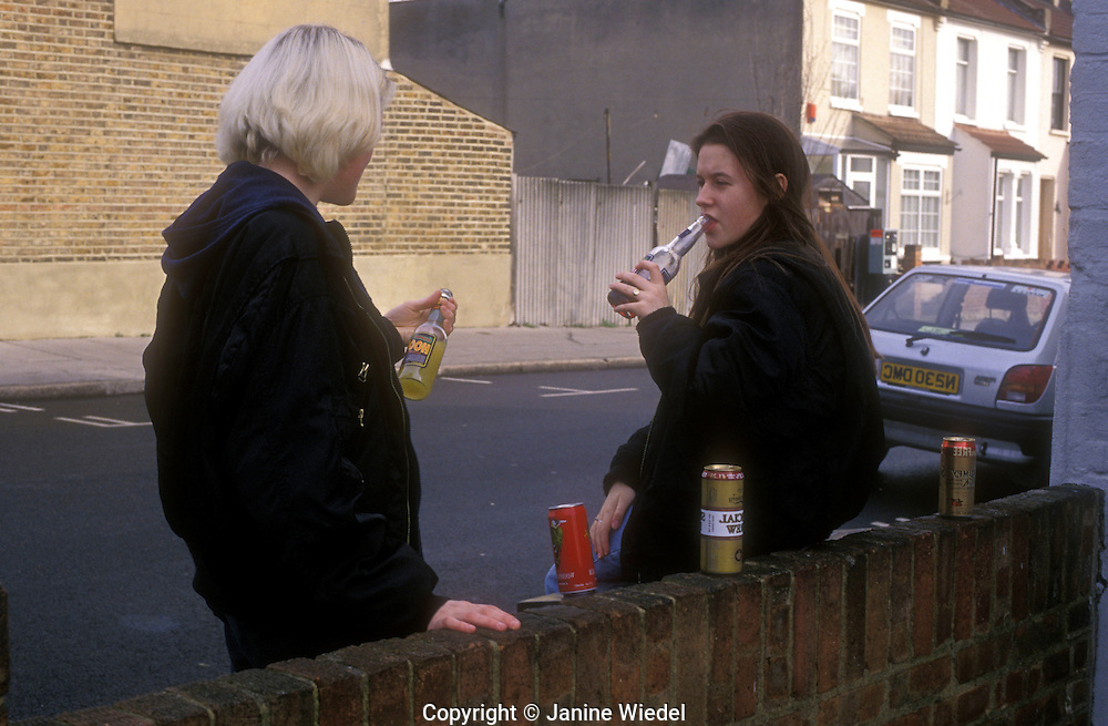 Teenagers hanging out smoking and drinking.