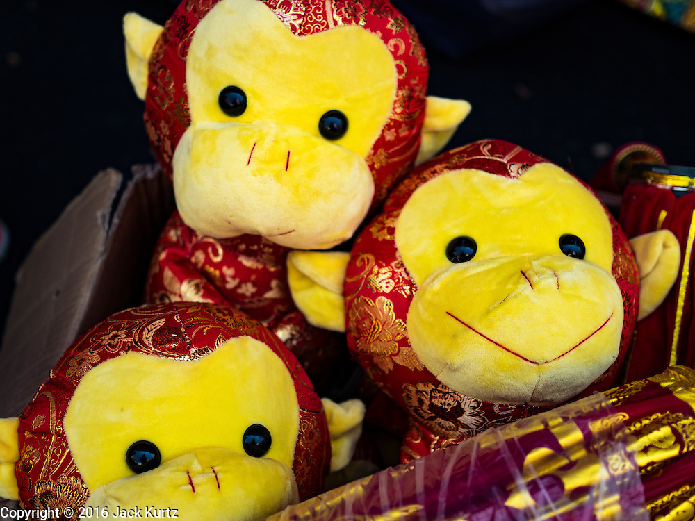 "31 JANUARY 2016 - BANGKOK, THAILAND: Monkey plush toys for sale ahead of Chinese New Year at a stand on Yaowarat Road in Bangkok's Chinatown. Chinese New Year, also called Lunar New Year or Tet (in Vietnamese communities) starts Monday February 8. The coming year will be the ""Year of the Monkey."" Thailand has the largest overseas Chinese population in the world; about 14 percent of Thais are of Chinese ancestry and some Chinese holidays, especially Chinese New Year, are widely celebrated in Thailand.           PHOTO BY JACK KURTZ"