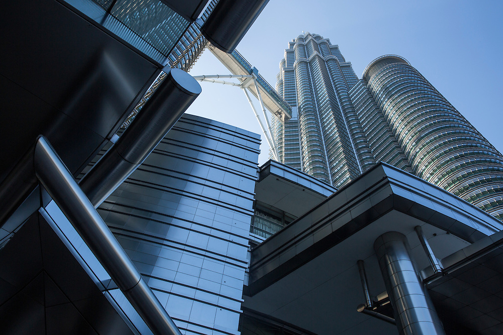 Malaysia, Kuala Lumpur, Low angle view from base of 88 story tall Petronas Towers skyscraper