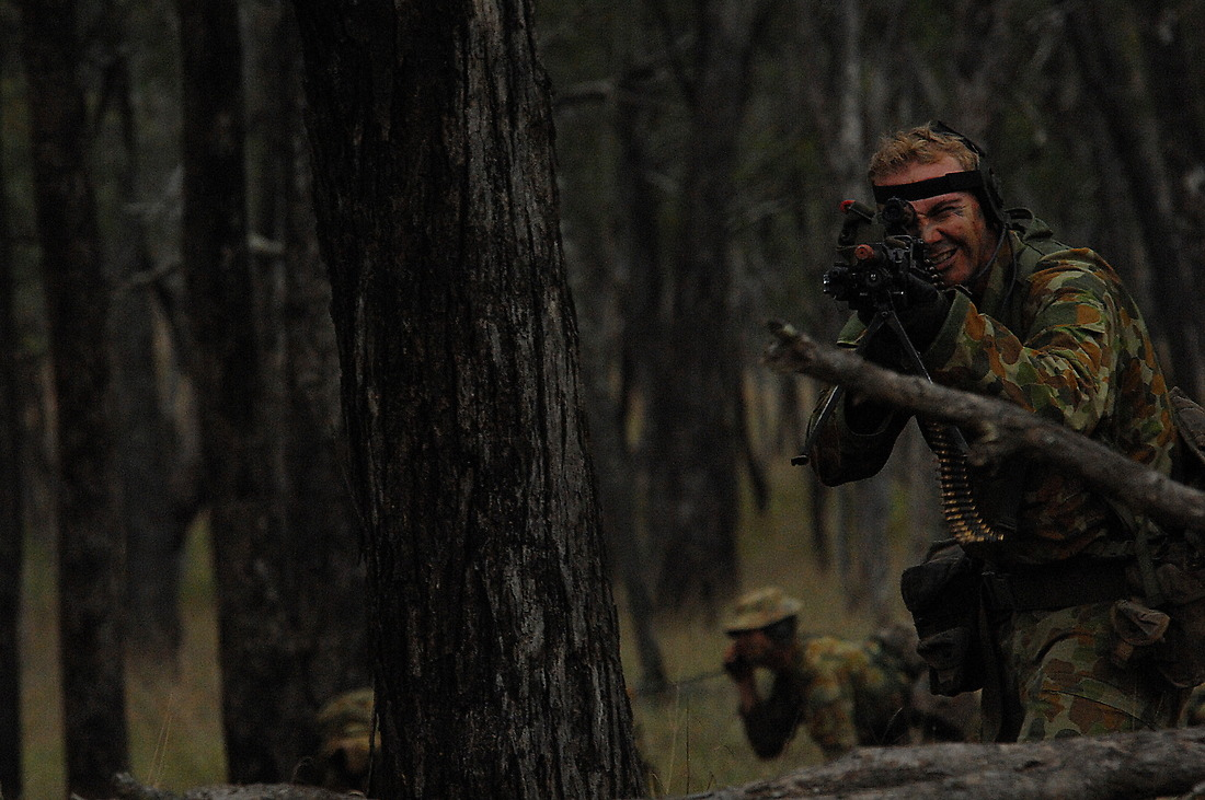 An Australian army soldier returns fire on opposing forces. — © Tsgt Jeremy Lock/