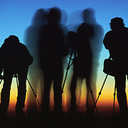 """Silhouettes of four photographers at sunrise on Mount Nemrut, in the Republic of Turkey. Published in """"Light Travel: Photography on the Go"""" book by Tom Dempsey 2009, 2010."""