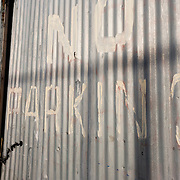 Corrugated iron gates padlocked and chained up to prevent trespassers.