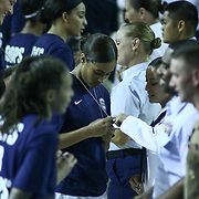 "United States Guard Skylar Diggins (18) ""CENTER"" examines her commemorative dog tags at half time of a USA Women's National Team Exhibition game between Red and White Thursday, Sept. 11, 2014 at The Bob Carpenter Sports Convocation Center in Newark, DEL"