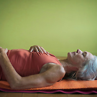 Mature woman practicing restorative yoga.<br />