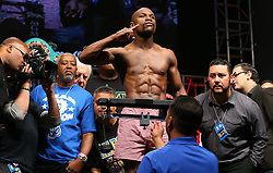 """LAS VEGAS, NV - MAY 2: Floyd """"Money"""" Mayweather Jr. weighs in for his WBA/WBC welterweight championship fight against Marcos Maidana at the MGM Grand Garden Arena on May 2, 2014 in Las Vegas, Nevada. (Photo by Ed Mulholland/Golden Boy/Golden Boy via Getty Images) *** Local Caption ***Floyd Mayweather; Marcos Maidana"""