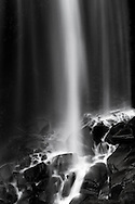 Closeup of the base of Narada Falls during late Summer in Mount Rainier National Park, Washington State, USA