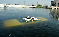A police car is submerged in New Orleans East August 31, 2005 after Hurricane Katrina hit the area. Authorities struggled on Wednesday to evacuate thousands of people from hurricane-battered New Orleans as food and water grew scarce and looters raided stores, while U.S. President George W. Bush said it would take years to recover from the devastation.
