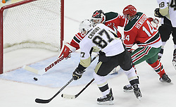 Mar 17; Newark, NJ, USA; New Jersey Devils goalie Martin Brodeur (30) makes a diving save on Pittsburgh Penguins center Sidney Crosby (87) during the first period at the Prudential Center.