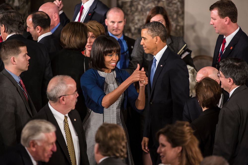 Michelle Obama gives two thumbs up at the Inaugural Luncheon in Statuary Hall at the U.S. Capitol on Monday, January 21, 2013 in Washington, DC.