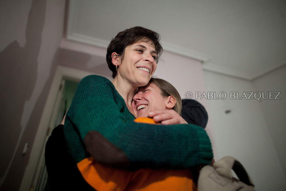 Tatyana Roeva (L) thanks to an anti-eviction supporter that came from La Rioja to stop Tatyana's eviction on February 28 2012. Bulgarian Tatyana Roeva, and husband Anuar Jalil 55, from Libano, await their second evition since last June 2011 their first eviction meant the starting of the Anti-eviction movement. A day before their eviction February 29, 2012 a demonstration of hundreds of people takes part in Madrid claiming a lieu of payment for evicted families and social accomodation. During the demonstration lawyer Rafael Mayoral and the Anti-eviction organization got a deal with BBVA Bank for a lieu of payment of 269.000, plus two months paid accomodation, but the couple needs to leave their house that night.