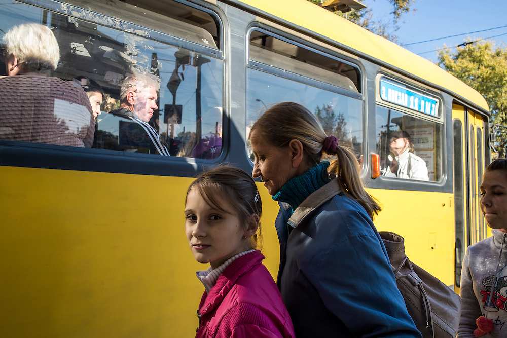 DNIPROPETROVSK, UKRAINE - OCTOBER 12: Yeva, 10, and her grandmother, Svitlana Kostromina, prepare to board a tram to begin the long trip from the Good News Evangelical Church to the home where they are living with a family that is part of the congregation on October 12, 2014 in Dnipropetrovsk, Ukraine. Yeva and her family fled fighting in Luhansk. The United Nations has registered more than 360,000 people who have been forced to leave their homes due to fighting in the East, though the true number is believed to be much higher.(Photo by Brendan Hoffman/Getty Images) *** Local Caption *** Svitlana Kostromina