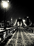 Walking on the brooklyn Bridge during a snow storm on a cold winter night, New York, 2008.