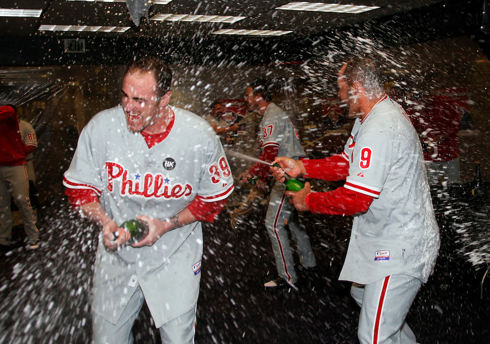 Philadelphia Phillies Brett Myers (L) and Miguel Cairo celebrate in the dressing room after the Phillies defeated the Colorado Rockies in their MLB National League Division Series playoff baseball game in Denver, October 12, 2009.     REUTERS/Rick Wilking (UNITED STATES SPORT BASEBALL IMAGES OF THE DAY)