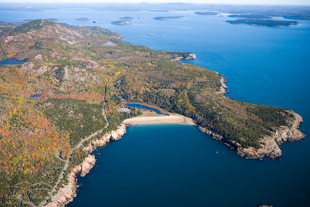 Sand Beach and Great Head from the air in Maine's Acadia National Park.  Fall.  Ocean Drive.  The Porcupine Islands are in the distance.