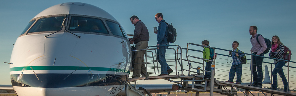 Chris McGee and family board an Alaksa Airlines jet at Seattle, WA  cmcgee@alaskagrowth.com