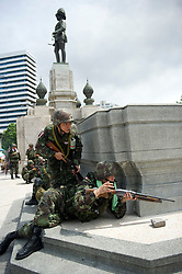Thai soldiers move into the Red-shirt camp in Lumpini Park during the military crackdown to end the Red-shirt protests.