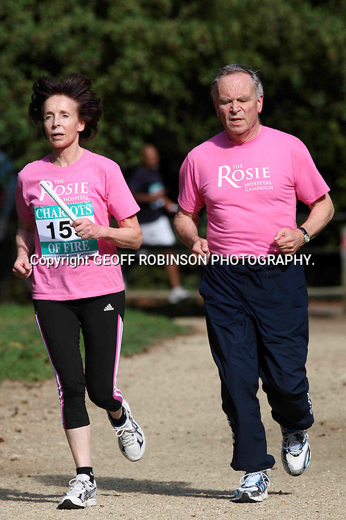 PIC SHOWS JEFFREY AND MARY ARCHER DURING THE CHARIOTS OF FIRE RACE IN CAMBRIDGE ON SUNDAY MORNING 18 SEPT... Novelist Jeffrey Archer ran by courageous wife Mary's side at a charity race today (Sun) as she made her first public appearance since overcoming a potentially fatal form of bladder cancer...The former politician was NOT registered in the race but wanted to be by his wife's side as she bravely ran 1.7 miles just FIVE MONTHS after undergoing major surgery to have the diseased organ removed...Out of sight of the judges, Lord Archer sneakily joined the race 200 metres after the start and pulled out 100 metres before the finish so he could support Dr Archer in the famous Chariots of Fire relay race...Dr Archer, 66, who only discovered she had an aggressive form of cancer last November, looked delighted as her husband jogged along with her through the scenic streets and colleges of Cambridge...Before the race she said he had been a huge support throughout her battle with cancer and had helped her prepare for the race...SEE COPY CATCHLINE  Jeffrey Archer runs with post cancer Mary