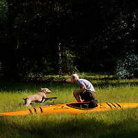 LIVE OAK, FL -- September 30, 2010 -- Boatwright Aaron Wells of Cypress Kayaks LLC, plays with his dog, Isabella, near his workshop in Live Oak, Fla., on Thursday, September 30, 2010.  (Chip Litherland for Bay Magazine)