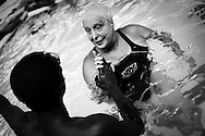 Jane Katz, a professor at at the John Jay College leads a swim class for incarcerated youths at the school's pool in New York, July 17, 2010. Keith Bedford for the New York Times