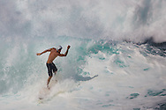 Surfing on the North Shore. Surfers hit the big waves, cresting over 12 feet.