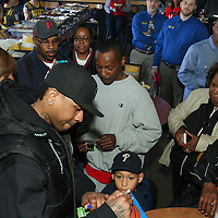 Philadelphia Sixers legend Allen Iverson signs a basketball for young fan during a Delaware 87ers season ticket holders meet & greet Saturday, Apr. 05, 2014 at Buffalo wild wings in Wilmington, DEL.
