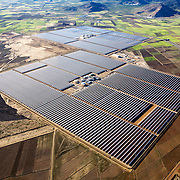A view of the Andasol 1 and 2, a parabolic through power plants located in Granada, Spain. With a gross electricity output of around 180 GWh per year and a collector surface area of over 510, 000 square meters - equal to 70 soccer pitches - they are the largest solar power plants in the world..Following their construction period of around two years, the Andasol power plants will supply up to 200,000 people with environmentally friendly solar electricity.