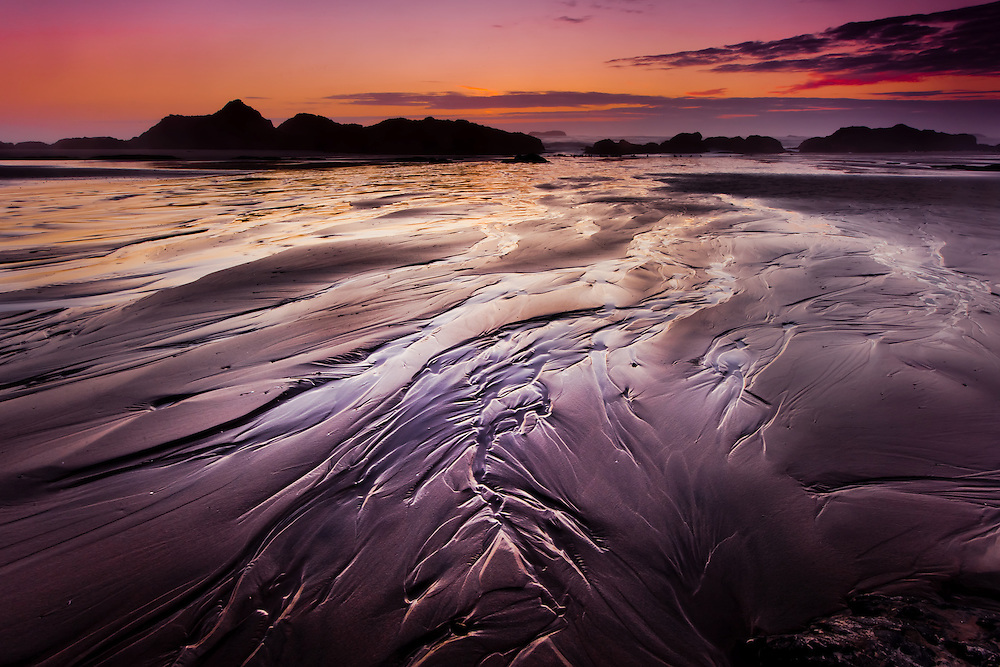 The receeding tide leaves patterbs etched in the sand on the Oregon Coast