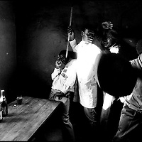 WARRIORS SOWETO SOUTH AFRICA 1990: Inkatha Freedom Party supporters brandish a gun and traditional weapons in a workers hostel in Dobsonville, Soweto 1990.  Violence in South Africa leading up to the first democratic elections in 1994 claimed tens of thousands of lives. (Photo by Greg Marinovich / Getty Images)